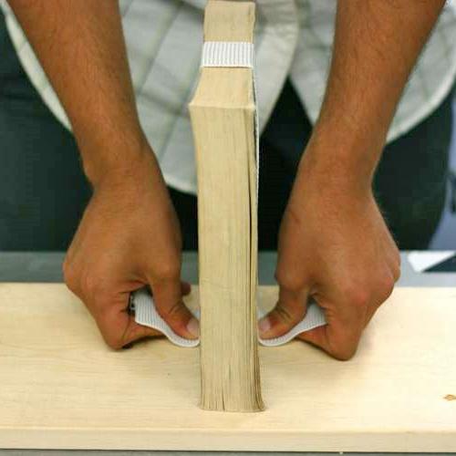 Измерение книжек для определения оптимальной длины эластичной ленты